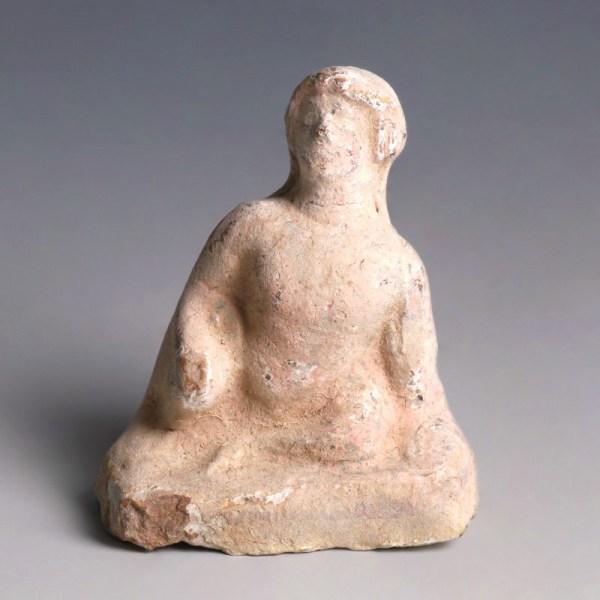 Greek Terracotta Figurine of a Seated Man