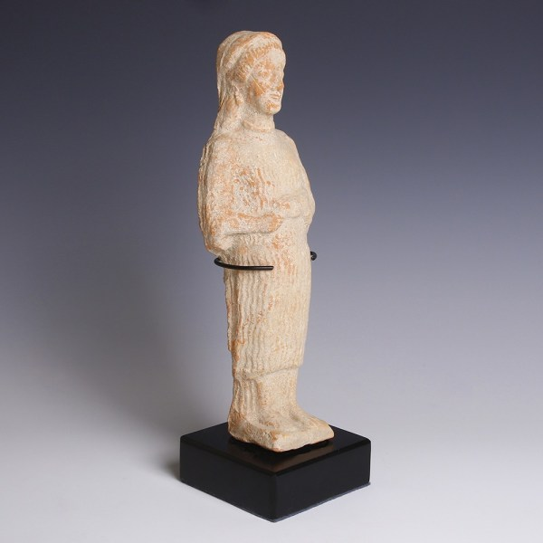 A Greek Terracotta Female Votary with Piglet