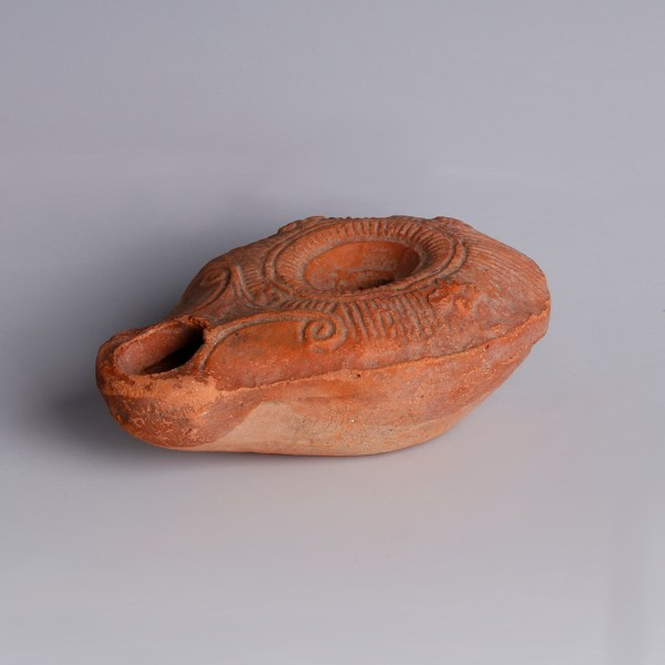Roman Oil Lamp with Linear Design and Rosettes