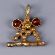 Western Asiatic Gold Pendant with Granules and Garnet Beads
