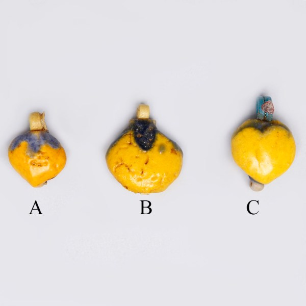 Selection of Egyptian Yellow Faience Mandrake Amulets