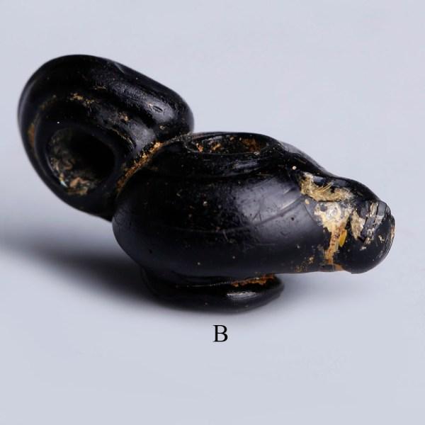 Selection of Roman Black Glass Pendants