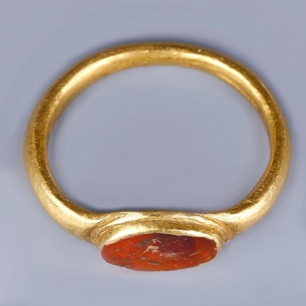 Roman Gold Ring with Garnet Intaglio of an Animal
