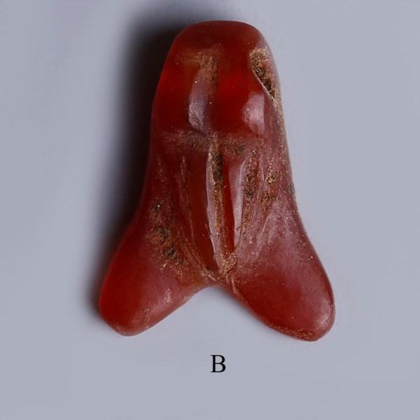 selection of egyptian carnelian fly amulets b