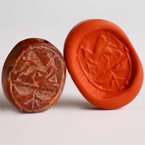 Southern Levantine Red Stone Scaraboid Seal with Griffin