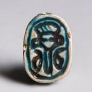 Egyptian Turquoise-Glazed Steatite Scarab with Hathor Emblem