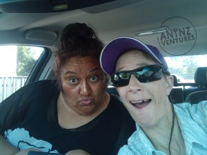 "Wairemana Campbell on left making a ""ducky face"", Antnz on right with a goofy smile. They are in the front seat of a car."