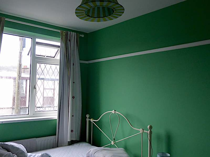 green bedroom with lampshade
