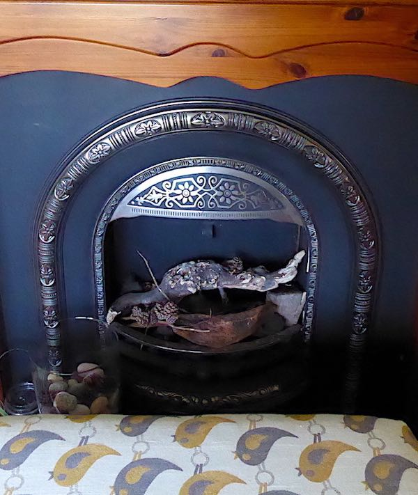 mahogany fireplace and penguin pattern love seat