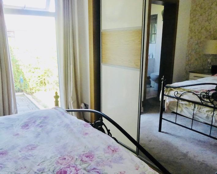 bedroom reflected in slide robes