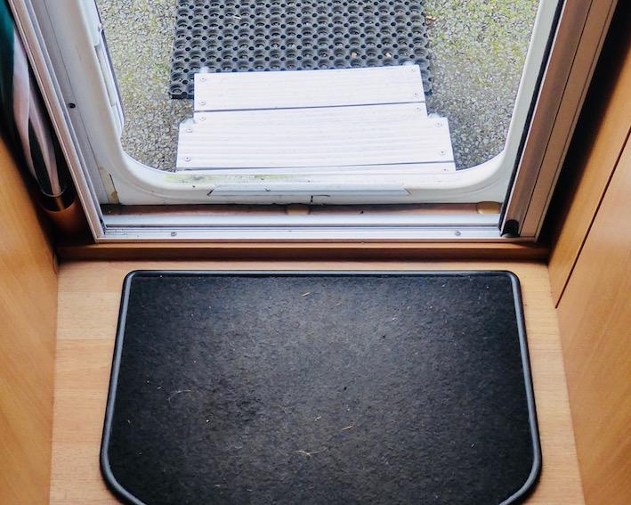 caravan door, step and mat