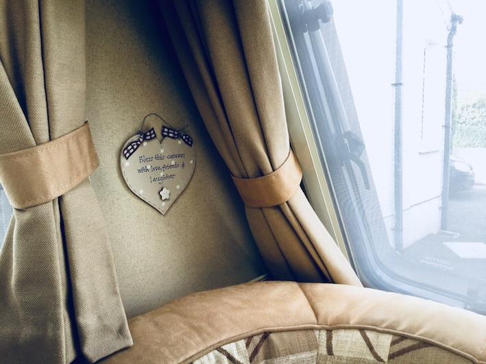 detail of caravan curtains and seating