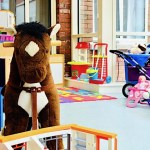 toy donkey and toys in play area of women's refuge