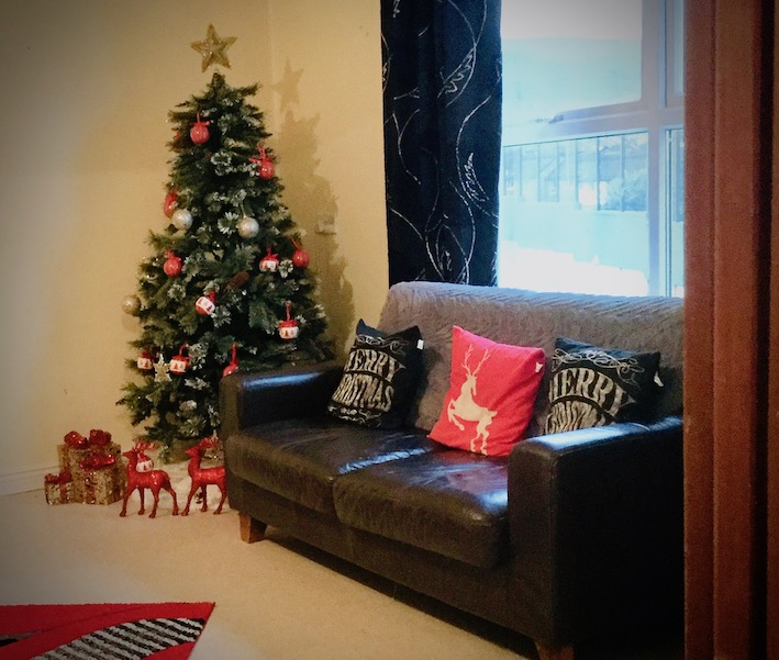 black sofa with christmas tree