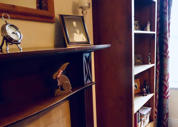 vintage mahogany fireplace and bookcase