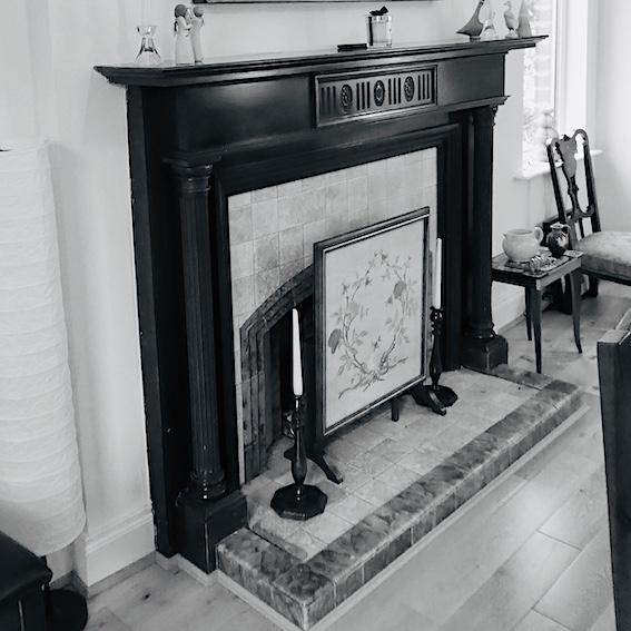 B & W image of vintage mahogany fireplace