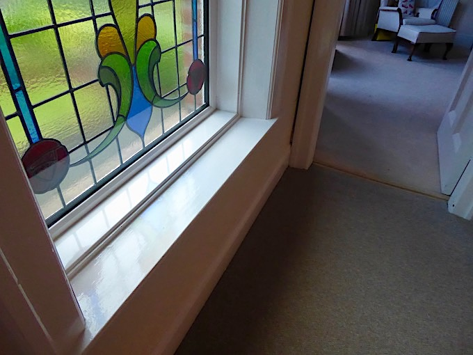 stained glass window and view into bedroom