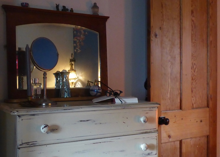 distressed finish drawers, mirror and stripped pine door