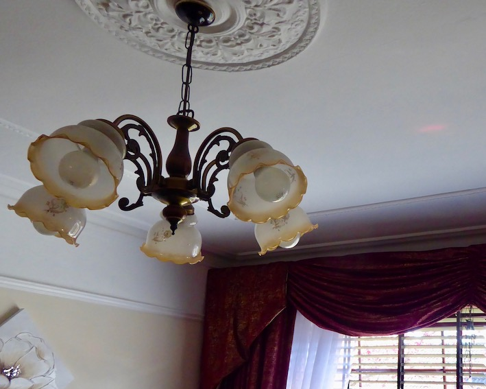 ceiling rose and light, swags and tails on window