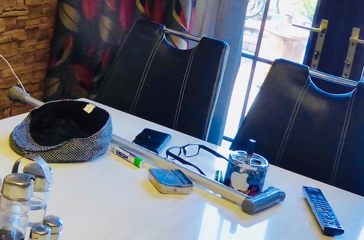 father's seat and belongings on kitchen table