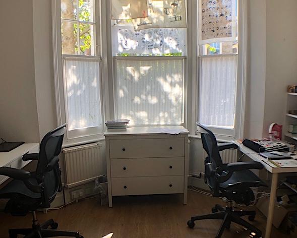 2 desks by bay window