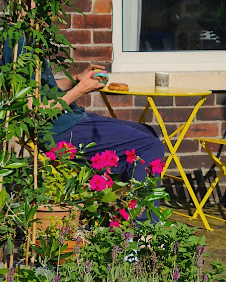 son with autism in garden with slinky