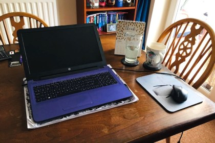 laptop on dining table working from home