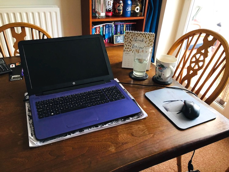 dining table with volunteer's laptop