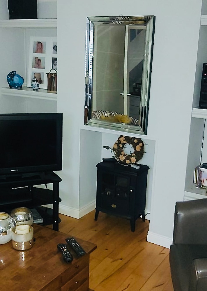 my own fireplace with mirror and TV