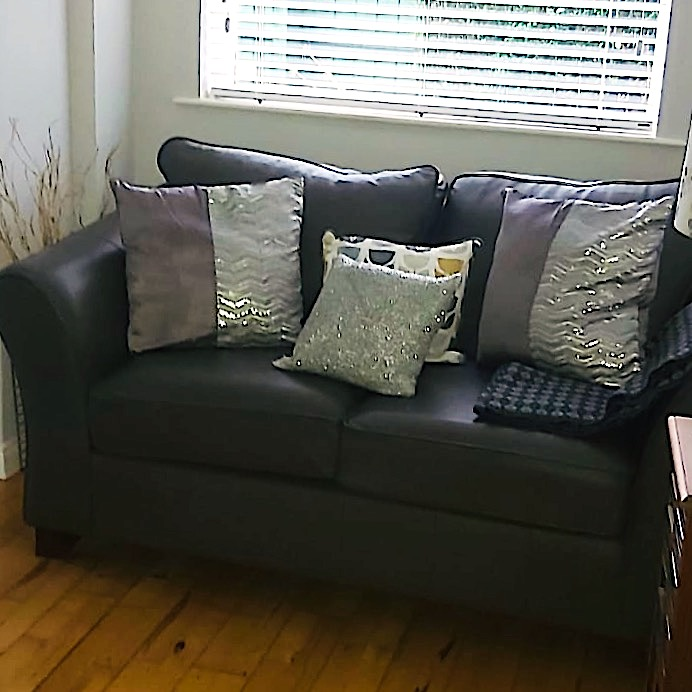 my own sofa and cushions by window