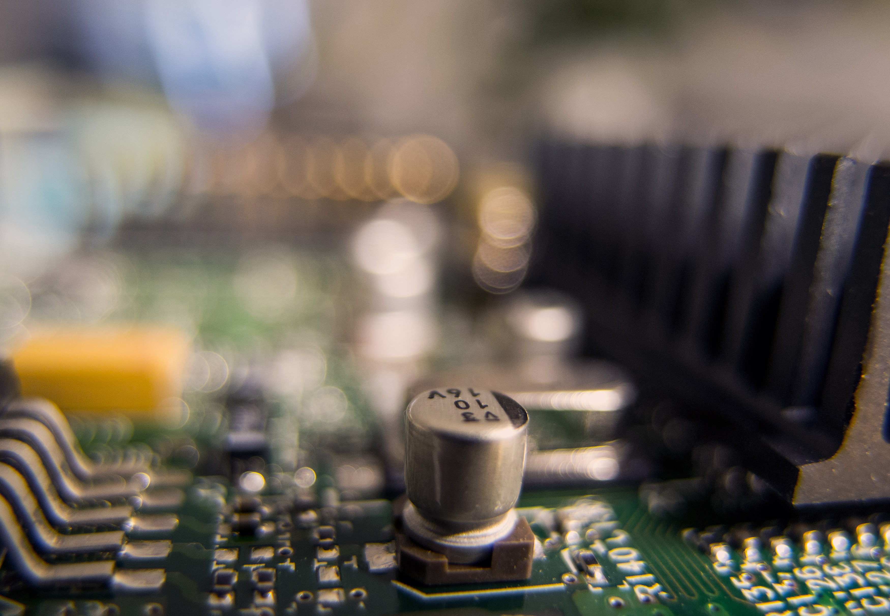 Closeup image of a circuit board - AnyPcFixed Ltd - Laptop Repair, Service & Upgrade in Leicester