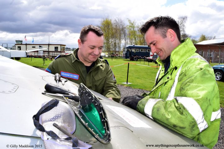 Chairman of the Bentwaters Aviation Society and Manager of the museum,Graham Haynes with volunteer Mark Shields - working on the Harrier wiring before the event.