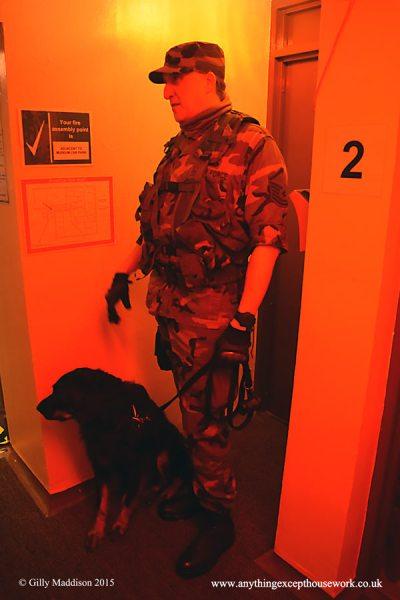 Museum volunteer Jon Saunders on duty with Lanie inside the bunker.