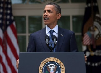 Obama speaking at the White House
