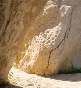 Archeology marks on a desert boulder