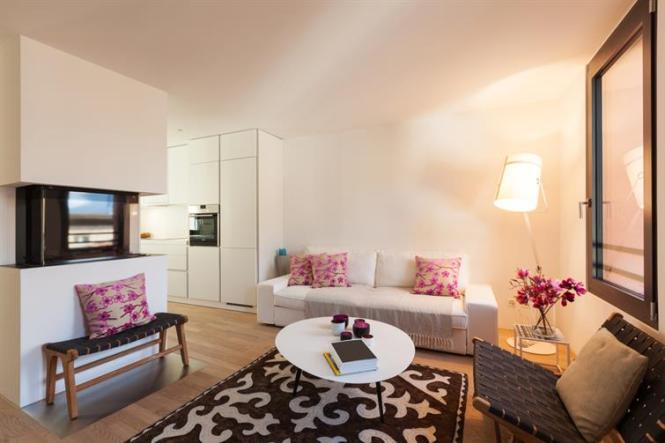 How Area Rugs Can Colorfully Transform A Plain Apartment