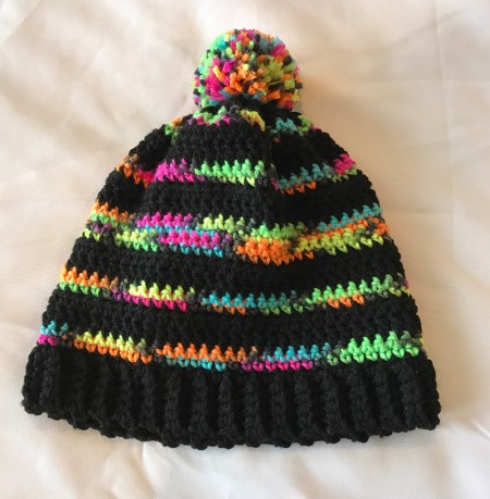I adore this crochet hat!  The bright colors just pop against the black!  Great free pattern!