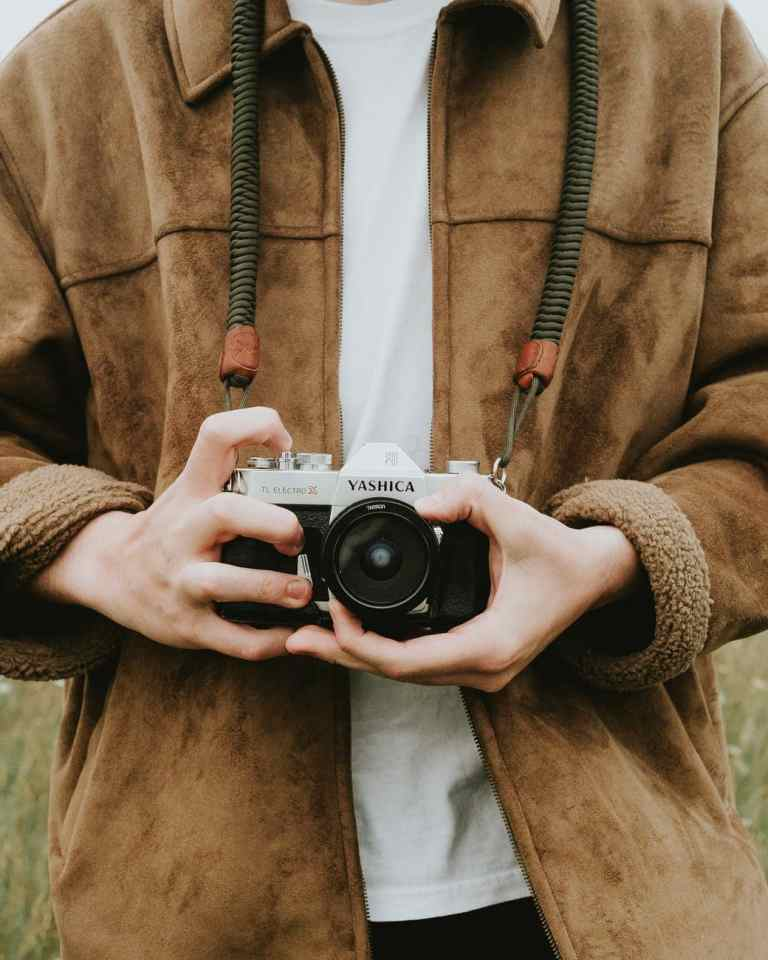 Person holding a camera
