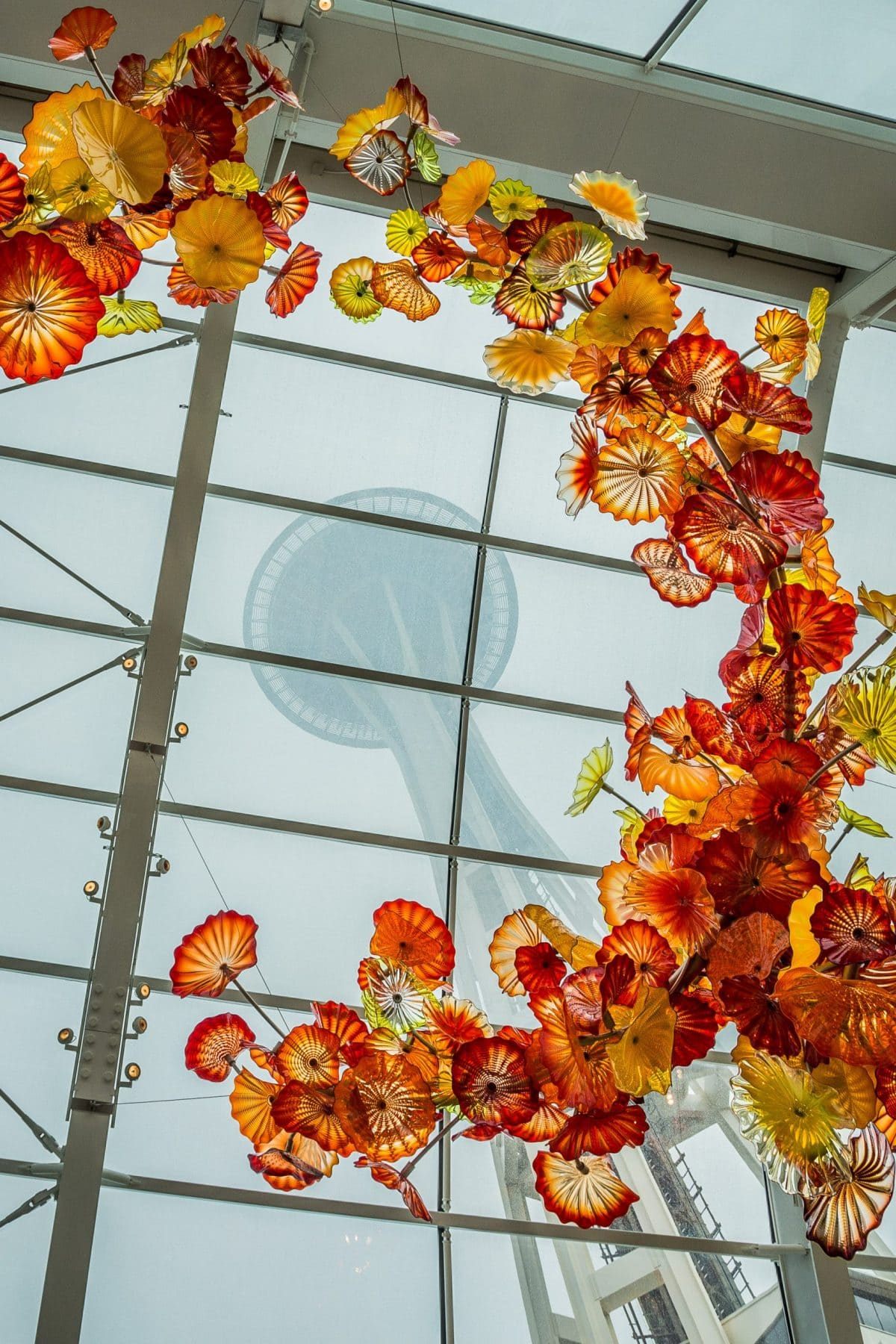 Chihuly Glass Art frames Seattle Space Needle through glass ceiling