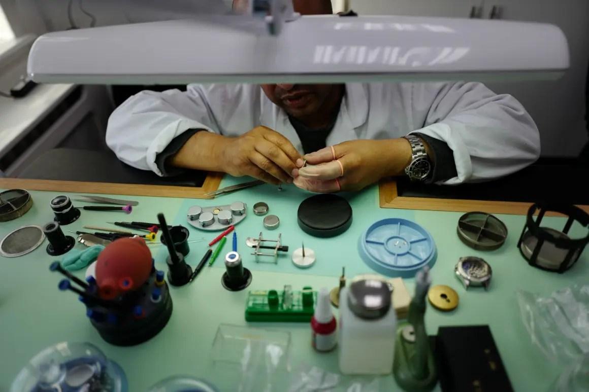 Man servicing a mechanical watch