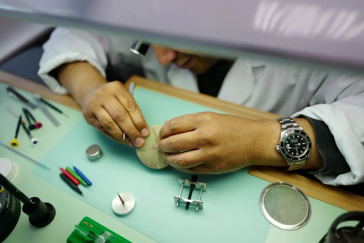 Man dismantling and servicing a watch