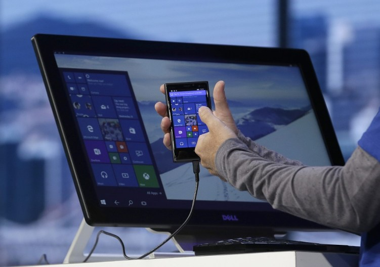 "alt=""Joe Belfiore, Microsoft Corporate Vice President of Operating Systems Group, demonstrates Continuum for phones at the Microsoft Build conference"""
