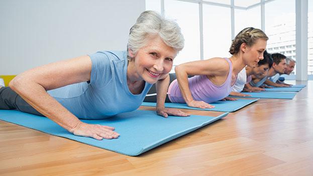 """elderly people practicing yoga"""
