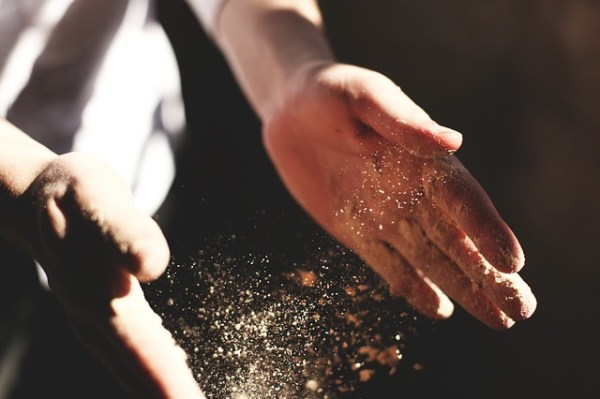 """""""Dust particles between two human hands."""""""