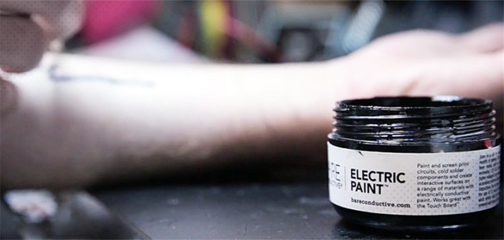 "alt-""Electric Paint used for High-tech Tattoo"""