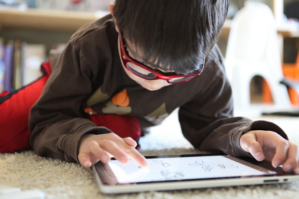 A little boy using a tablet