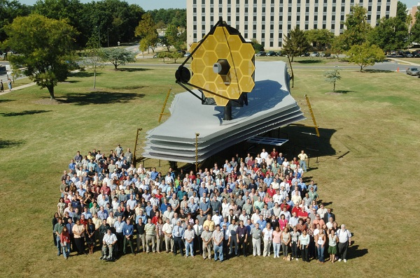 James Webb space telescope surrounded by people