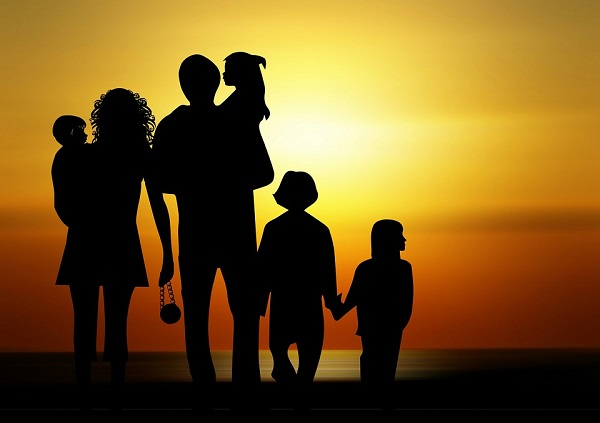 silhouettes of happy people at sundown