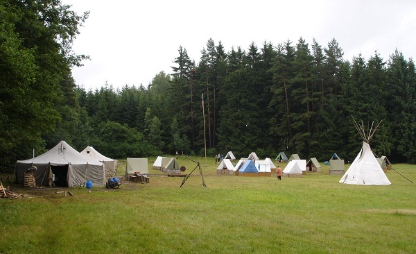 Tents at a scout summer camp in the forest