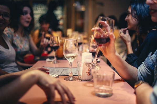 People sitting at a table and drinking wine